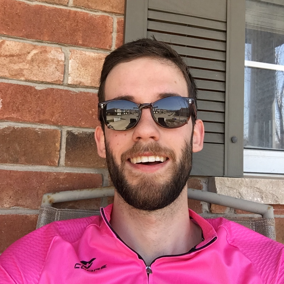 Josiah in pink shirt with sunglasses on